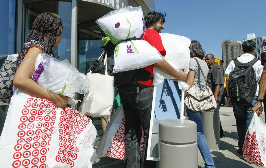Shoppers, like these at a Chicago Target store in 2012, don't have as much to spend. Photo: Sitthixay Ditthavong, Associated Press