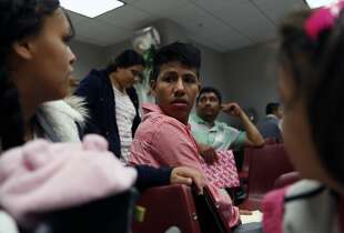 Eduardo Morales, 17, an unaccompanied minor who entered the US illegally from El Salvador, waits for his immigration court hearing with his cousin's wife, Jessica Martinez, (left) and another cousin, Angely Garcia, 6, in San Francisco, Calif. on Tuesday, August 26, 2014.