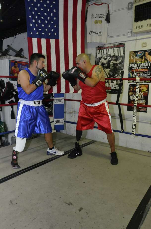 Lower-limb amputee fighters from the National Amputee Boxing Association in San Antonio square up in the ring. The group is the only sanctioned boxing association for amputees in the country. Photo: Courtesy, NABA Facebook