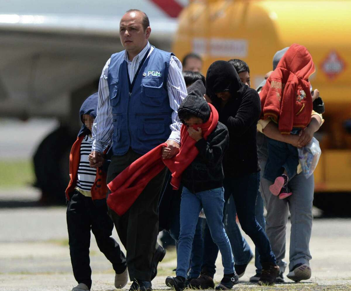 Part of a group of thirteen children, aged between one and 13, and seven mothers walk upon arrival in Guatemala deported from the United States amidst the humanitarian crisis caused by Central American immigrant children, at the Air Force Base in Guatemala City on July 22, 2014. US authorities have detained some 57,000 unaccompanied minors since last October, twice the number from the same period a year ago, seeking to illegally cross into the US from Mexico. Three quarters of the minors are from El Salvador, Guatemala and Honduras. AFP PHOTO / Johan ORDONEZJOHAN ORDONEZ/AFP/Getty Images