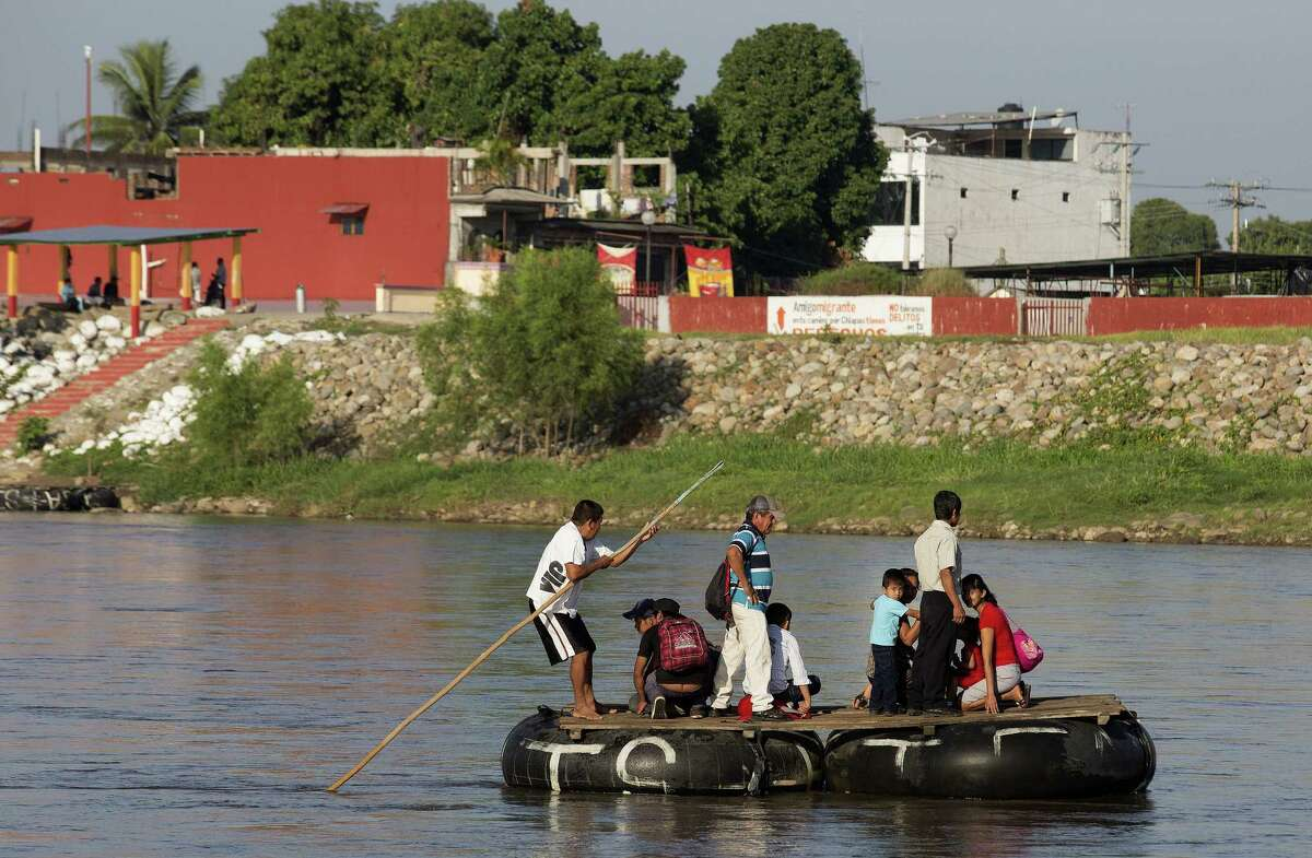 People travel on makeshift rafts across the Suchiate River from Tecun Uman, Guatemala, to Ciudad Hidalgo, Mexico, last month to avoid security and customs officials. The Guatemalan government has so failed its citizens that many prefer to face the dangers of illegal migration than stay home.