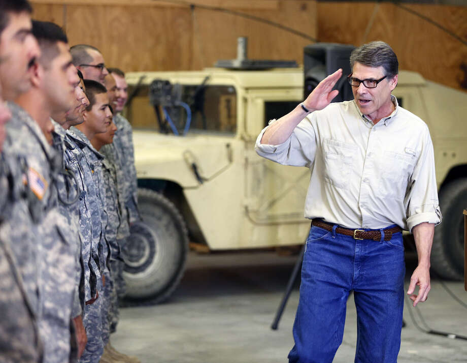 Gov. Rick Perry visits some of the National Guard troops he has ordered to the border. The crime figures he cited as reason for the mobilization don't add up. Photo: William Luther, Associated Press / San Antonio Express-News