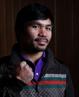 Manny Pacquiao poses for a portrait after meeting with the editorial board at the offices of The Chronicle on August 28, 2014 in San Francisco, Calif.