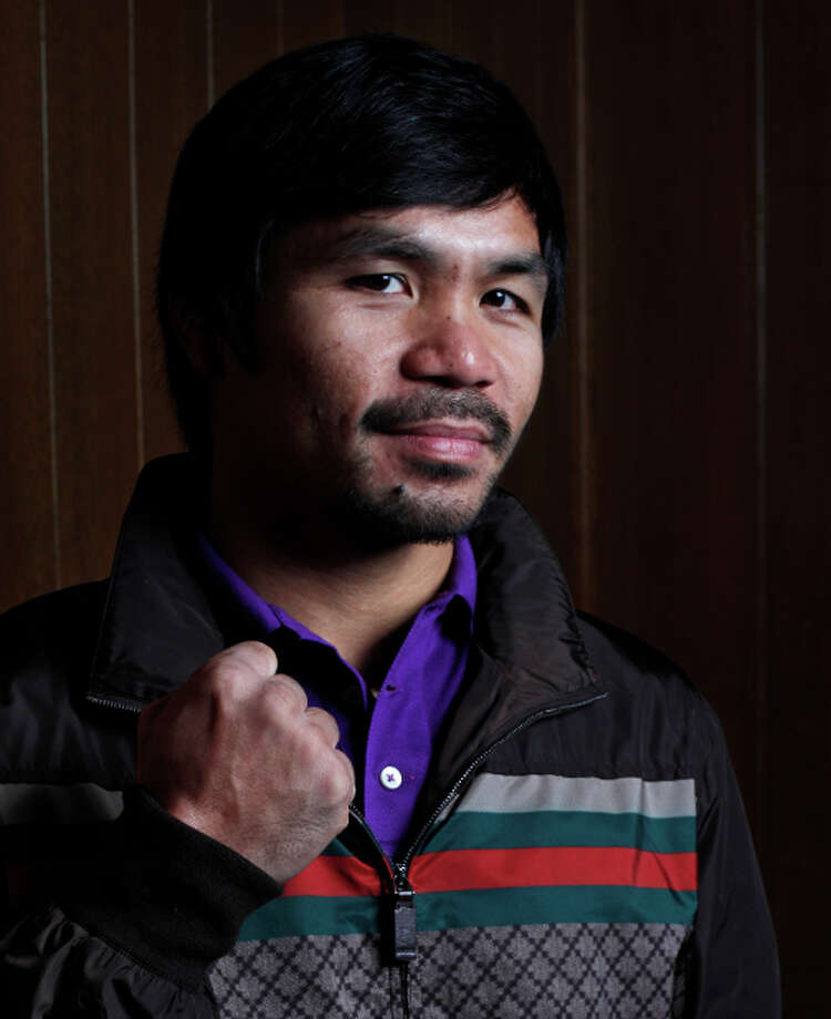 Manny Pacquiao poses for a portrait after meeting with the editorial board at the offices of The Chronicle on August 28, 2014 in San Francisco, Calif. Photo: Pete Kiehart / The Chronicle / ONLINE_YES