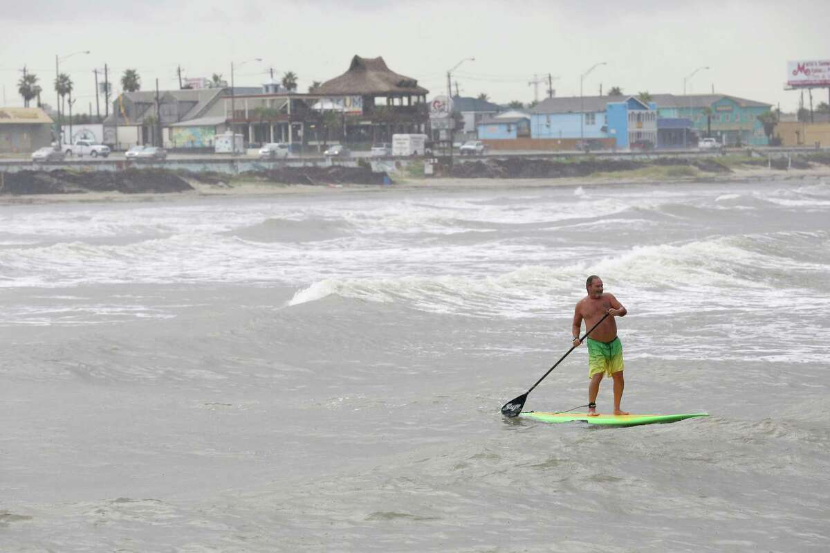 A paddle boarder paddle out to sea on August 28, 2014 on Galveston Beach in Galveston, TX.