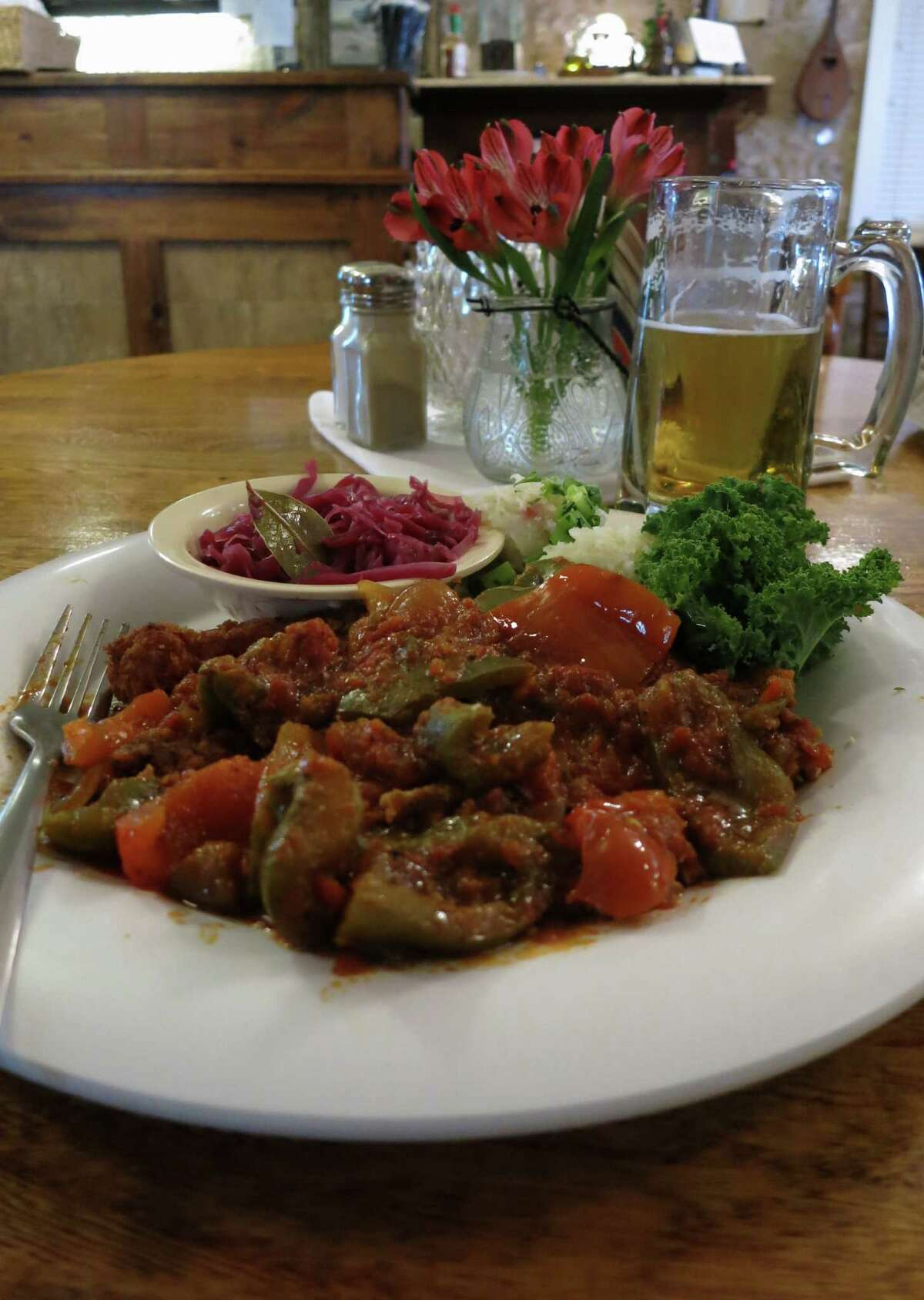 Der Lindenbaum serves a variety of schnitzels, including the Zigeuner Schnitzel, a tender cutlet of pork, breaded and pan-fried, topped with a spicy bell-pepper sauce.