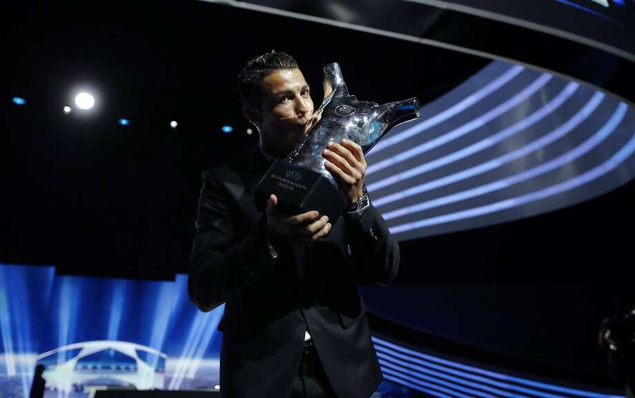 Real Madrid's Cristiano Ronaldo smooches his UEFA European Best Player of the Year trophy in Monaco. Photo: Valery Hache, AFP/Getty Images