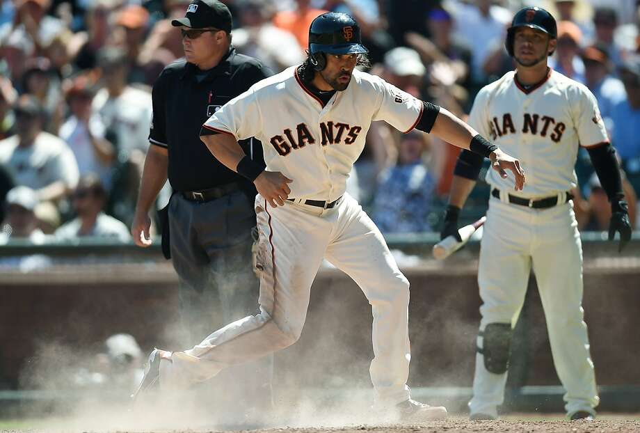 Angel Pagan gives the Giants a two-run cushion over the Rockies when he scores on a sacrifice fly by Hunter Pence in the sixth. Photo: Thearon W. Henderson, Getty Images