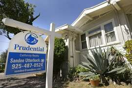 FILE - This Monday, July 14, 2014 file photo shows a home for sale in Alameda, Calif. Freddie Mac reports on average U.S. mortgage rates for this week on Thursday, Aug. 28, 2014. (AP Photo/Ben Margot, File)
