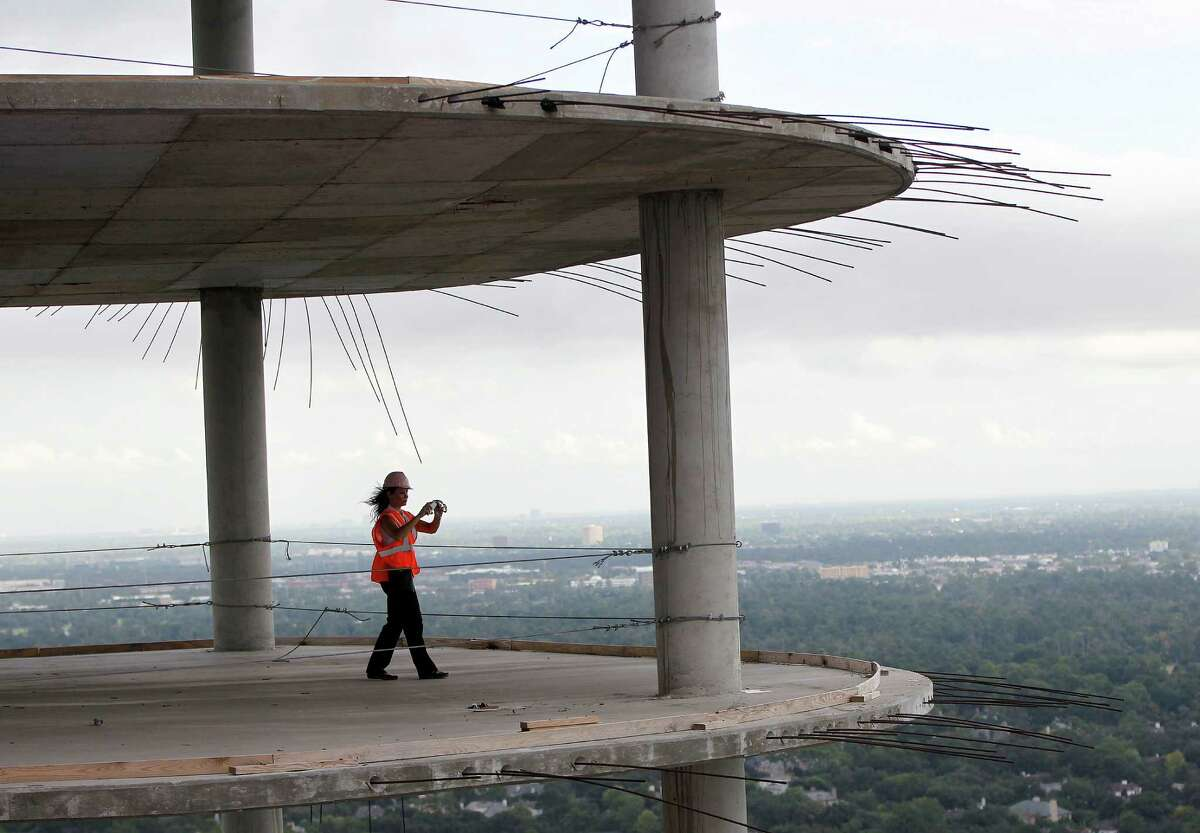 Misty Meredith, leasing agent for 2929 Weslayan, takes photos on the 38th floor of the 40-story residential high-rise under construction at 2929 Weslayan, Thursday, Aug. 28, 2014, in Houston. ( Karen Warren / Houston Chronicle )