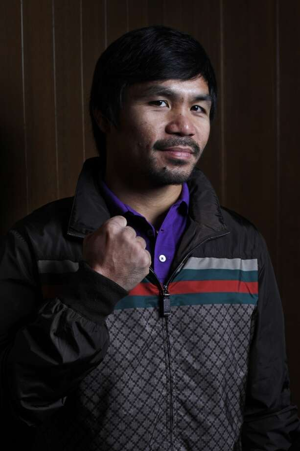Manny Pacquiao poses for a portrait after meeting with the editorial board at the offices of The Chronicle on August 28, 2014 in San Francisco, Calif. Photo: Pete Kiehart, The Chronicle