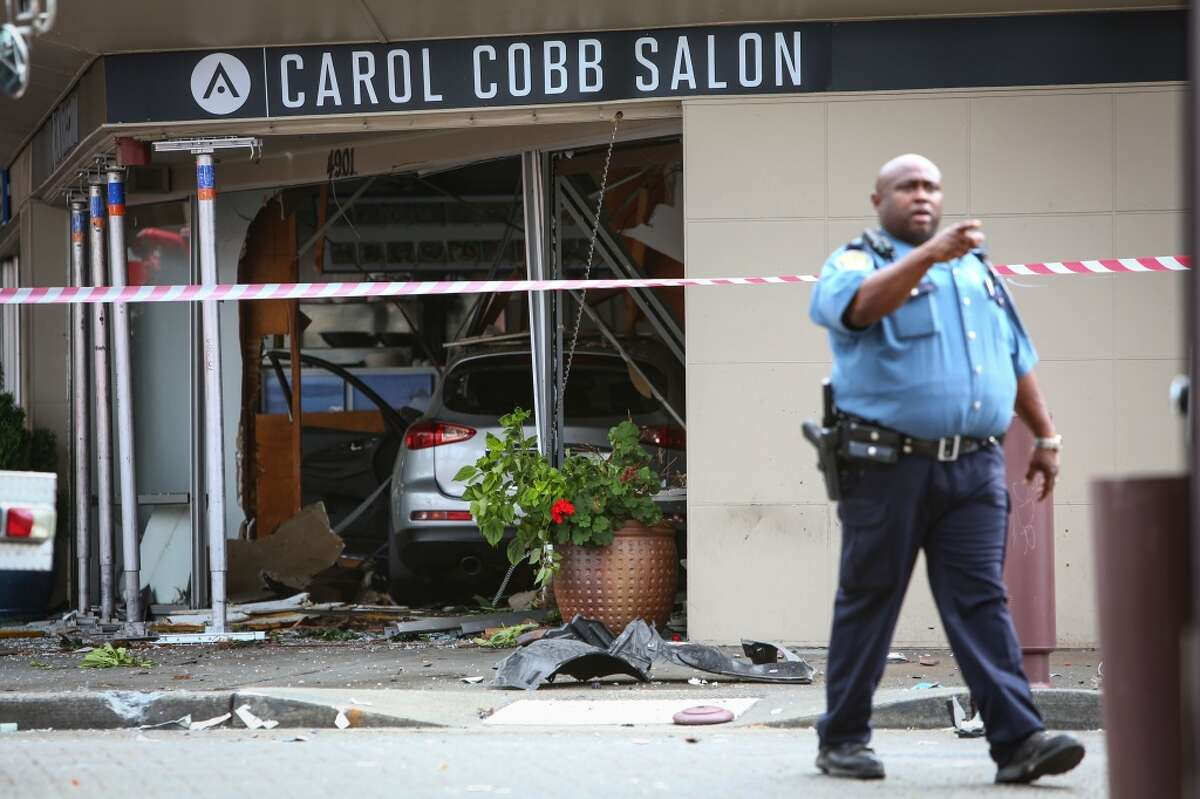 The Carol Cobb Hair Salon and The Grecian Delight building is shown after an SUV crashed into the historic Columbia City building. The crash injured 7 people. Photographed on Thursday, August 28, 2014. (Joshua Trujillo, seattlepi.com)