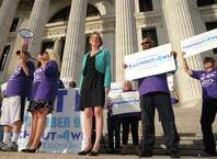 Democratic candidate for New York Governor Zephyr Teachout, center, makes a campaign stop at the State Education Building on Thursday Aug. 28, 2014 in Albany, N.Y.  (Michael P. Farrell/Times Union)