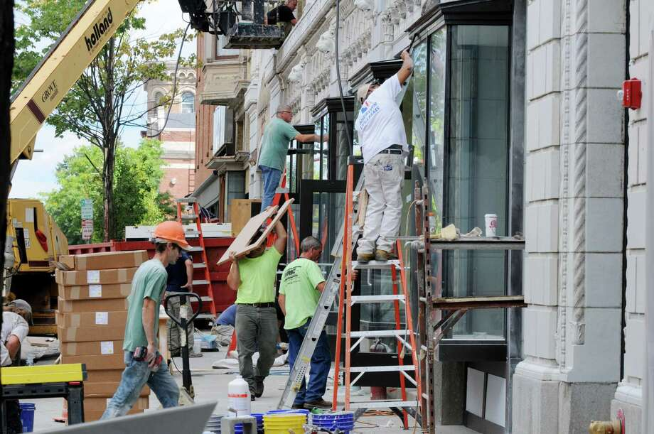 Workers finish renovations to the Proctor?s Theatre building Thursday, Aug. 28, 2014, in Troy, N.Y. The building will house the Rensselaer County Regional Chamber of Commerce, who begin moving in this weekend. They are current located on River Street. (Will Waldron/Times Union) Photo: WW / 00028382A