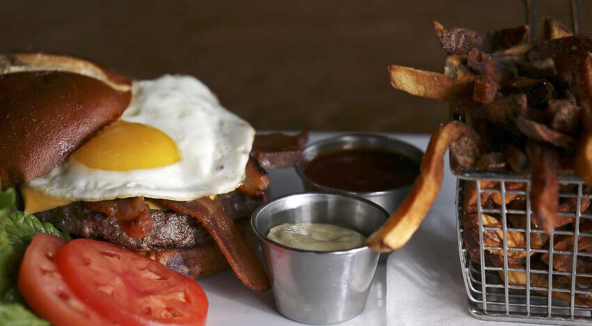 Fried egg and house-cured bacon are optional add-ons to the Big Hops Cheese Burger at the Big Hops Gastropub.