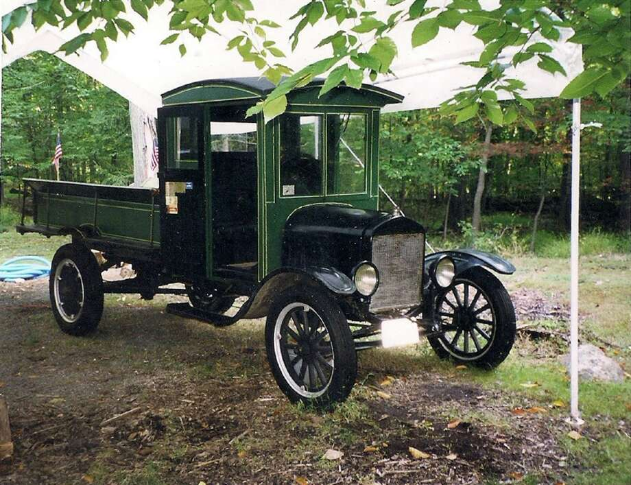 Typical of Ford trucks of that era, the 1927 Model T was made of metal from the firewall forward. The rest of the truck was primarily wood. The cozy wooden cab stands 6 feet, 6 inches high with an 8-foot-long wooden bed behind. The bed has a tailgate. Mounted atop the cab is a single taillight.