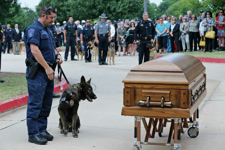 Canine officers and their handlers from around the state stopped at the casket of K-9 Kye following funeral services for the dog in Oklahoma City, Thursday, Aug. 28, 2014. K-9 Kye died Aug. 25 after being stabbed by a burglary suspect on Aug. 24.  Photo: Sue Ogrocki, Associated Press / AP