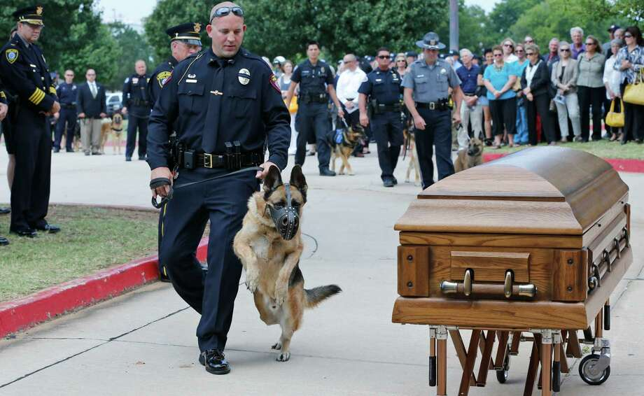 Canine officers and their handler from around the state stopped at the casket of K-9 Kye following funeral services for the dog in Oklahoma City, Thursday, Aug. 28, 2014.  Photo: Sue Ogrocki, Associated Press / AP