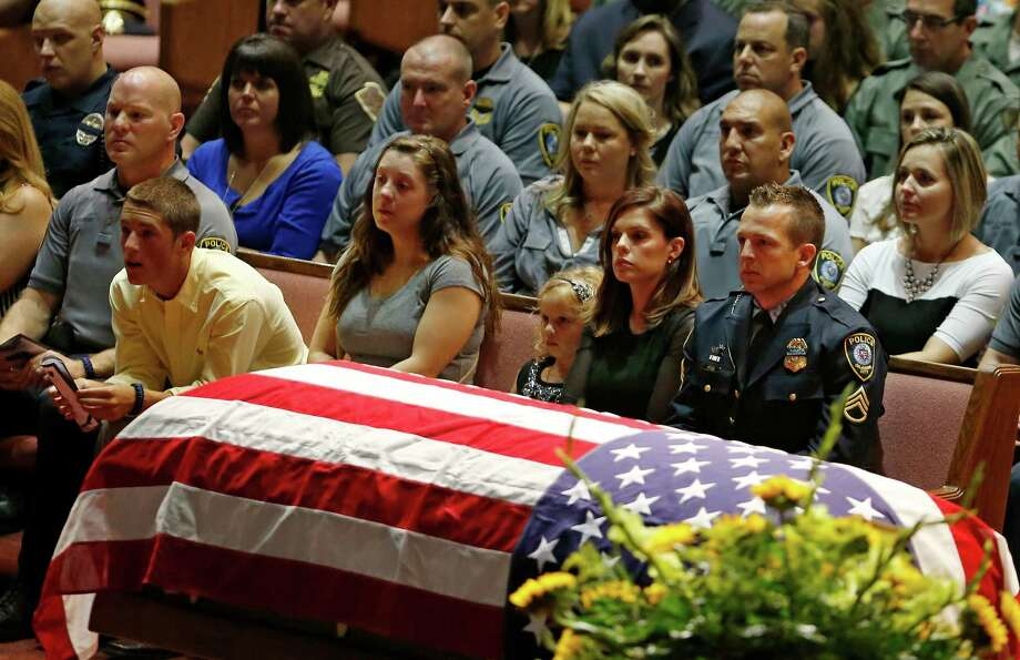 Oklahoma City police officer Sgt. Ryan Stark, right, looks at the casket of his canine partner, K-9 Kye, during funeral services for the dog at First Southern Baptist Church in Oklahoma City, Thursday, Aug. 28, 2014.  Photo: Sue Ogrocki, Associated Press / AP