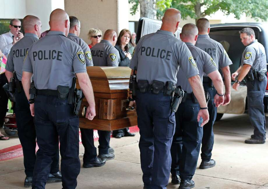 The casket of Oklahoma City canine officer K-9 Kye, is carried into a waiting hearse following funeral services for the dog in Oklahoma City, Thursday, Aug. 28, 2014.  Photo: Sue Ogrocki, Associated Press / AP