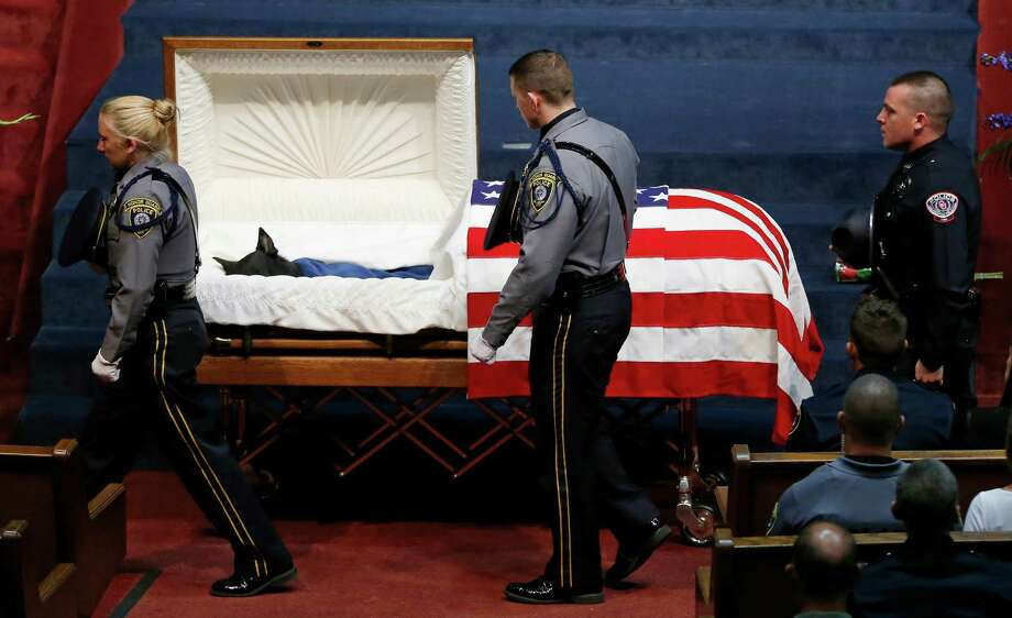 Police officers file past the casket of Oklahoma City police canine officer K-9 Kye during funeral services in Oklahoma City, Thursday, Aug. 28, 2014.  Photo: Sue Ogrocki, Associated Press / AP