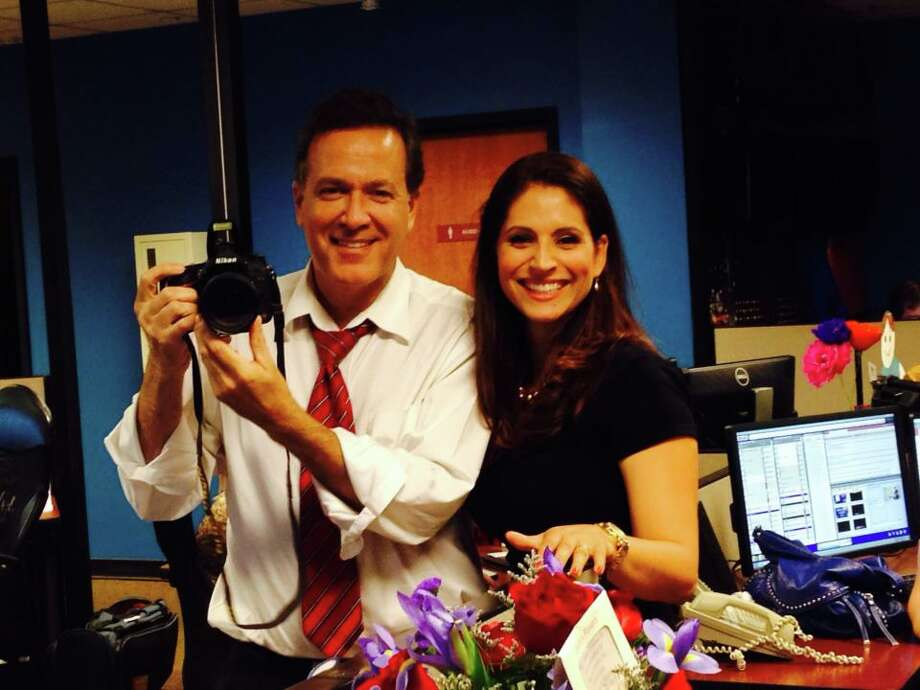 Randy Beamer came to the aid of his co-anchor Evy Ramos when she was too tearful to finish a news intro. Photo: Courtesy