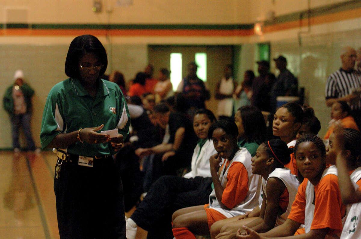 Sam Houston High School girls basketball coach Milyse Lamkin directs her team during a scrimmage on Wednesday, Nov. 2, 2005.