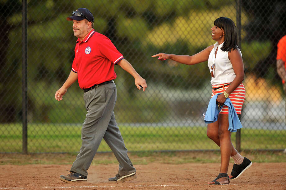 Board of Reps' third base coach Gloria DePina argues with umpire Charles Pia during the 31st annual Mayor's Team versus Board of Reps' Team softball game at Boccuzzi Park in Stamford, Conn., on Thursday, Aug. 28, 2014. Photo: Jason Rearick / Stamford Advocate