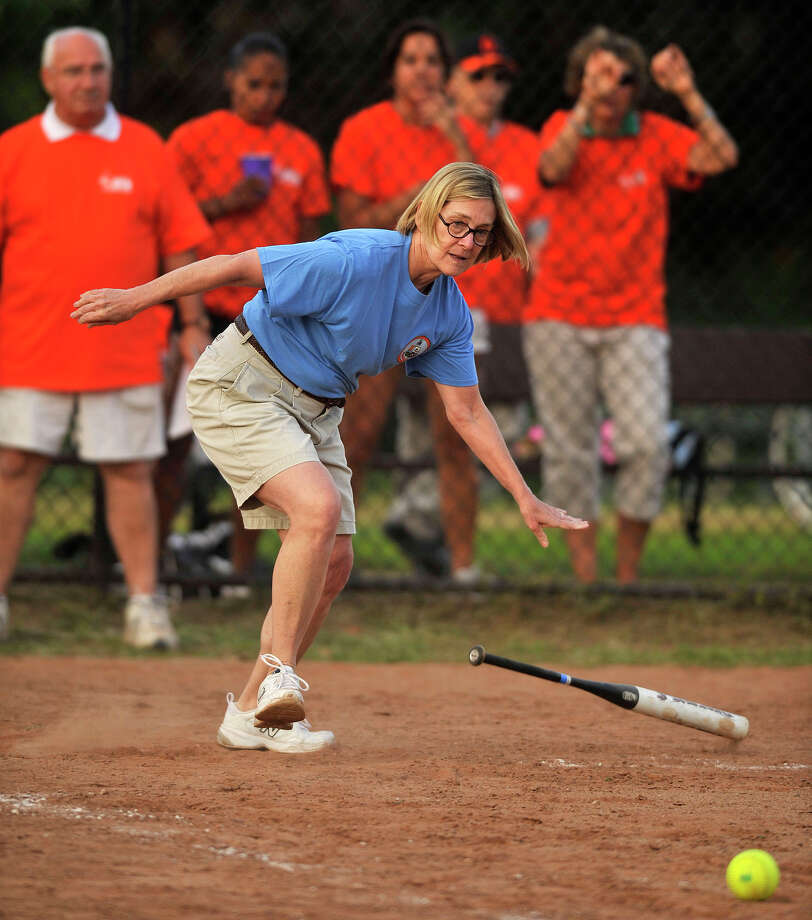 Board of Reps' Susan Nabel connects with the ball and reaches first during the 31st annual Mayor's Team versus Board of Reps' Team softball game at Boccuzzi Park in Stamford, Conn., on Thursday, Aug. 28, 2014. Photo: Jason Rearick / Stamford Advocate