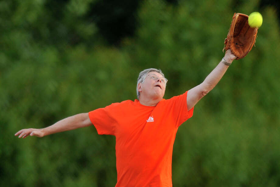 Mayor David Martin stretches to make a catch at second base during the 31st annual Mayor's Team versus Board of Reps' Team softball game at Boccuzzi Park in Stamford, Conn., on Thursday, Aug. 28, 2014. Photo: Jason Rearick / Stamford Advocate