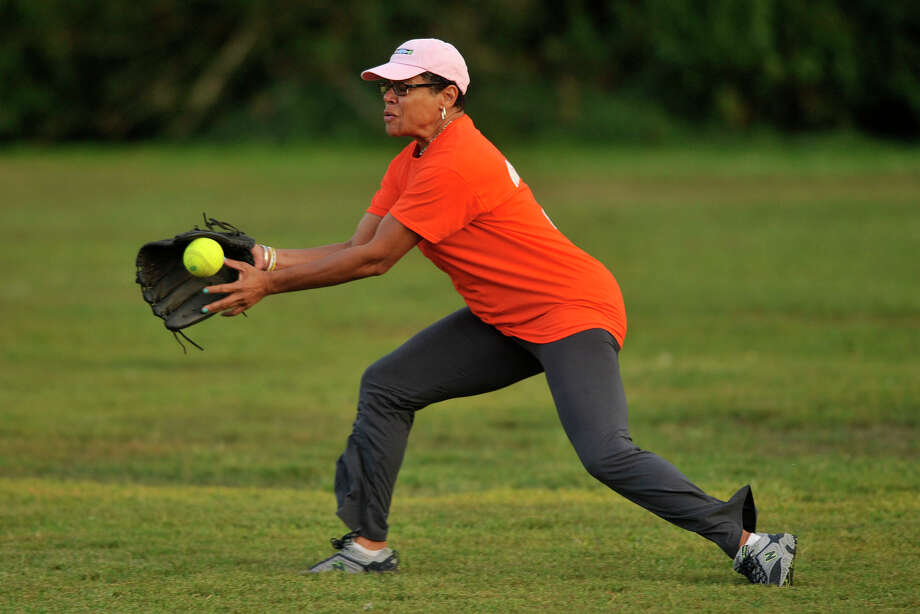 Right fielder Jere Eaton, with the Mayor's Team, fields a ball hit to her during the 31st annual Mayor's Team versus Board of Reps' Team softball game at Boccuzzi Park in Stamford, Conn., on Thursday, Aug. 28, 2014. Photo: Jason Rearick / Stamford Advocate