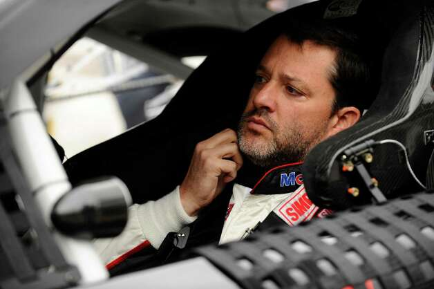 FILE - In this April 7, 2014, file photo, Tony Stewart prepares to start a NASCAR Sprint Cup series auto race at Texas Motor Speedway in Fort Worth, Texas. Stewart will return to Sprint Cup competition Sunday night at Atlanta Motor Speedway, ending a three-race hiatus taken after he struck and killed a fellow driver during a dirt-track race.  (AP Photo/Ralph Lauer, File) ORG XMIT: NY178 Photo: Ralph Lauer / FR52694  AP