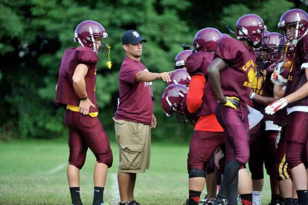 New Colonie High School football head coach Eric Rouleau works with his team during practice on Thursday, Aug. 28, 2014, in Colonie, N.Y.    (Paul Buckowski / Times Union) Photo: Paul Buckowski / 00028368A