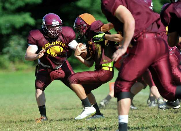 Colonie High School football lineman John Mullally, left,  runs through drills with his teammates  during practice on Thursday, Aug. 28, 2014, in Colonie, N.Y.    (Paul Buckowski / Times Union) Photo: Paul Buckowski / 00028368A