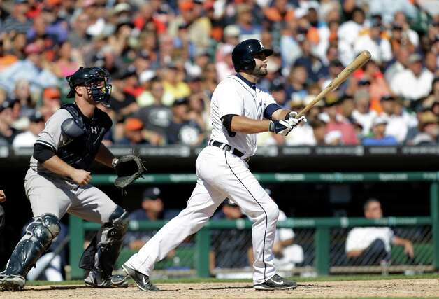 Detroit Tigers' Alex Avila hits a walk off single to score Bryan Holladay against the New York Yankees in the ninth inning of a baseball game in Detroit Thursday, Aug. 28, 2014. Detroit won 3-2. (AP Photo/Paul Sancya) ORG XMIT: MIPS113 Photo: Paul Sancya / AP