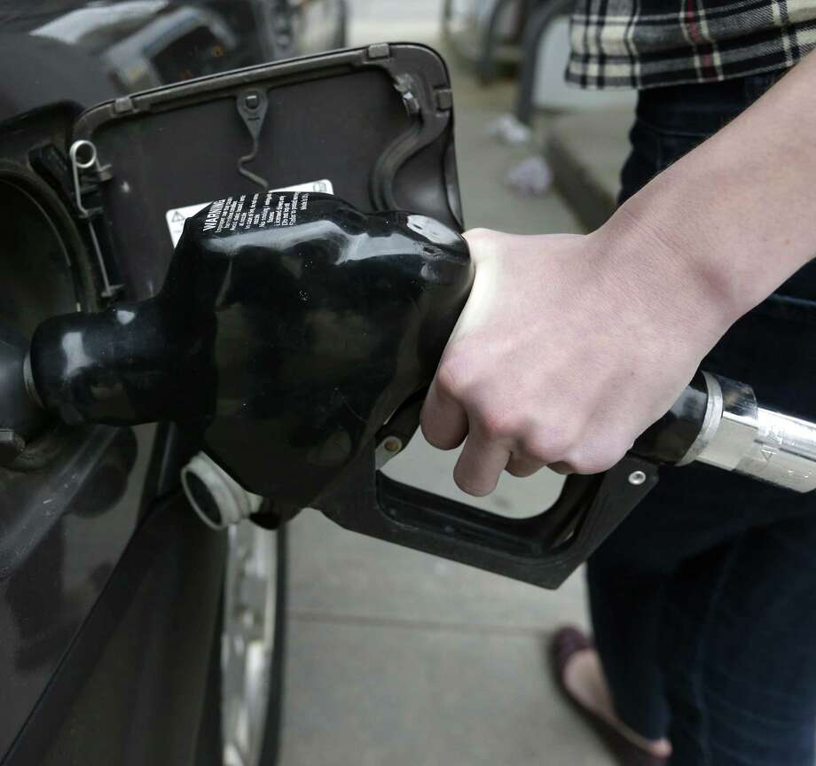 AAA expects more Texans to travel by car this Labor Day weekend than did last year over the holiday because of falling prices at the pump. Photo: Steven Senne / Associated Press / AP