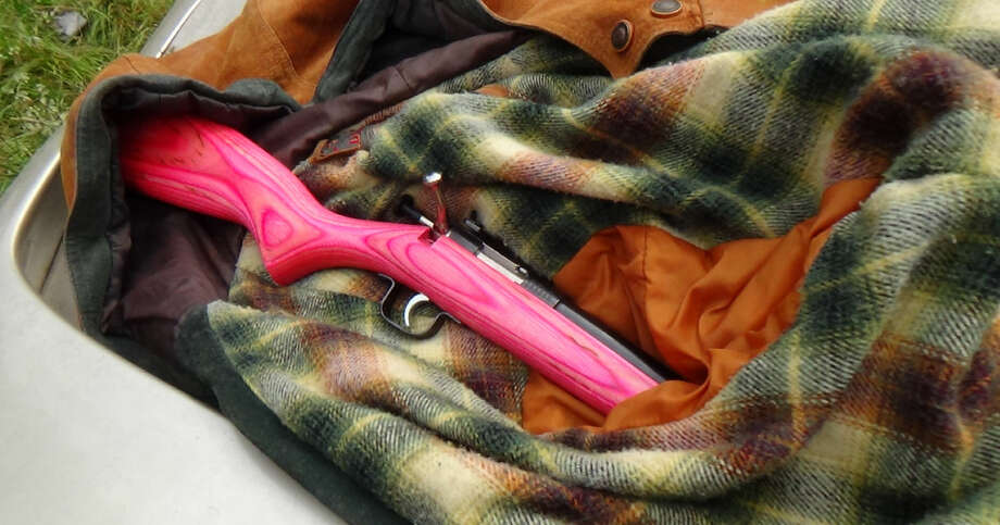 A hot pink .22 cal. rifle seized during an investigation into Carlos Carmona-Gonzalez, pictured in a Department of Justice photo.