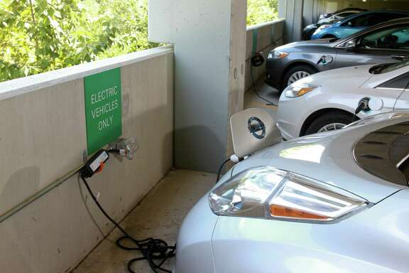 Electric cars in reserved parking spaces used for charging electric cars at BP's Westlake campus in West Houston (For the Chronicle/Gary Fountain, August 27, 2014)
