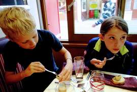 Travelers of all ages — here trying snails for the first time — can reach new gastronomic heights in France. RS14Spring_830.jpg