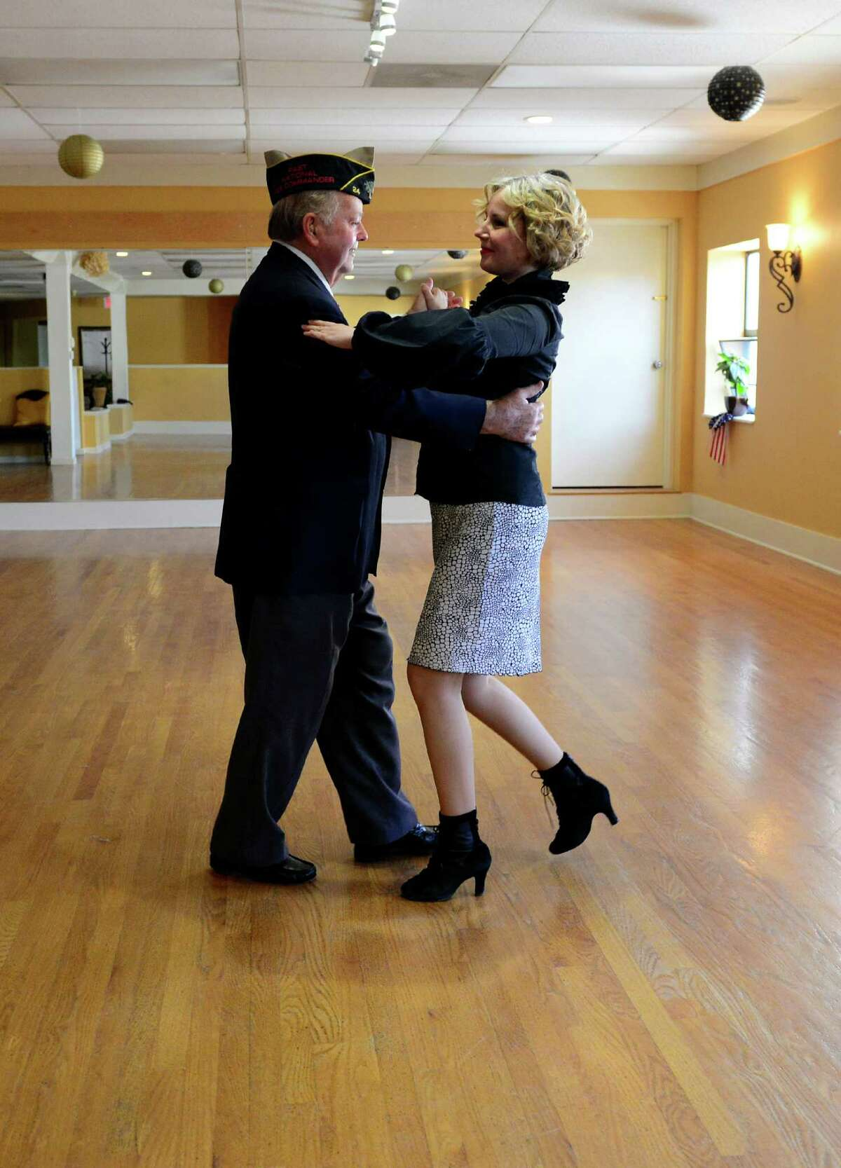 """Fred Astaire Dance Studio owner Monika Barska dances with Korean War-era veteran Gus Williams in Southport, Conn. on Thursday August 28, 2014. The Fred Astaire pros are teamed up with veterans to take part in the """"Dancing With Our Heroes"""" event in Hartford on September 13, 2014. The dance will help raise money to build a Fisher House at the VA in West Haven."""