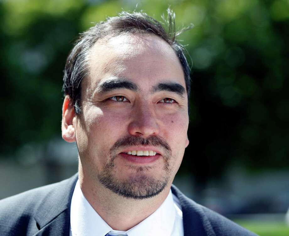 Tim Wu, a candidate for New York lieutenant governor, talks to reporters outside the state Capitol on Thursday, Aug. 28, 2014, in Albany, N.Y. The New York Times has endorsed Wu, who is running alongside liberal gubernatorial candidate Zephyr Teachout, over Gov. Andrew Cuomo's running mate Kathy Hochul. (AP Photo/Mike Groll) ORG XMIT: NYMG104 Photo: Mike Groll / AP