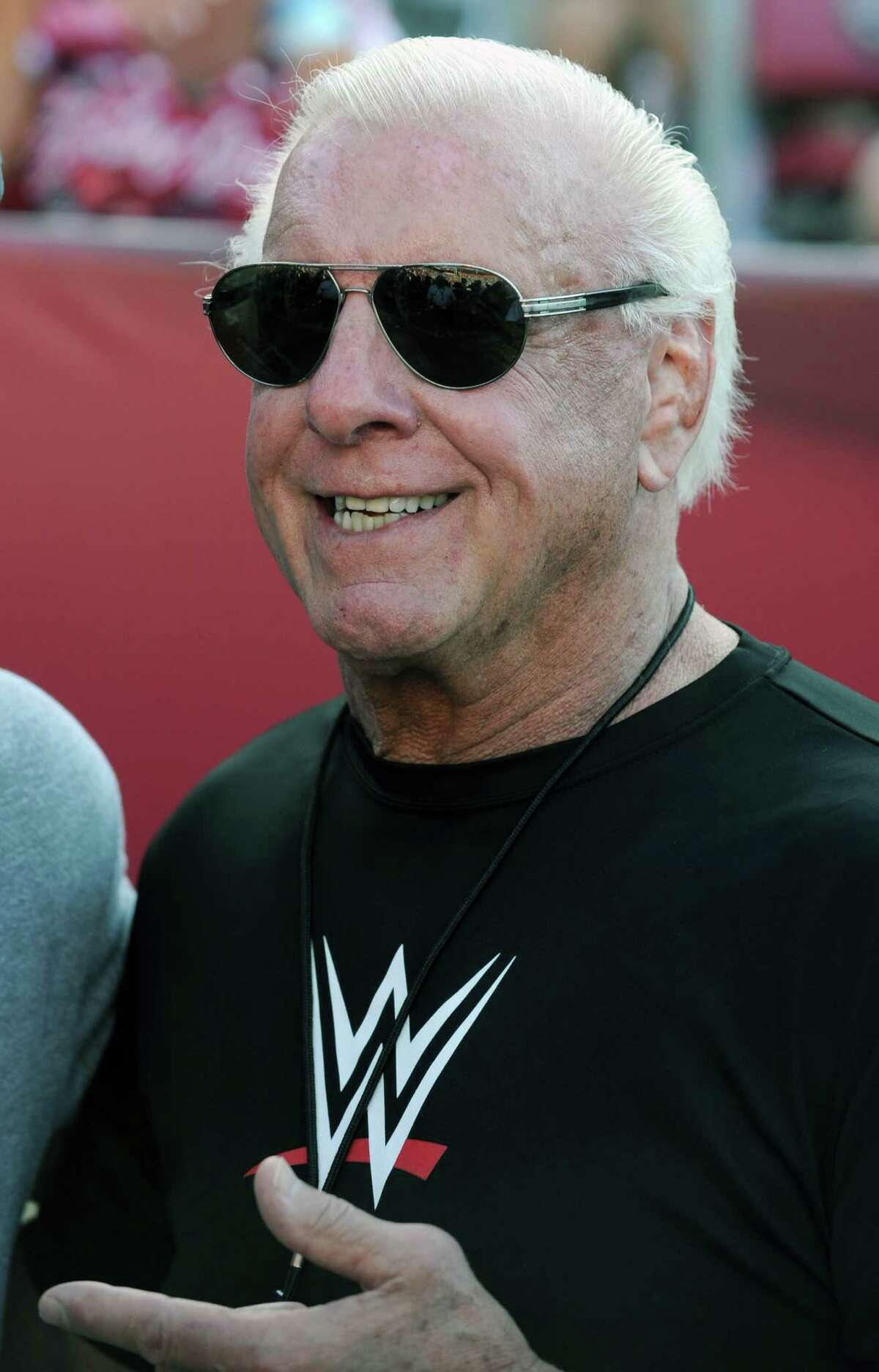 Former professional wrestler Ric Flair poses for photographs.