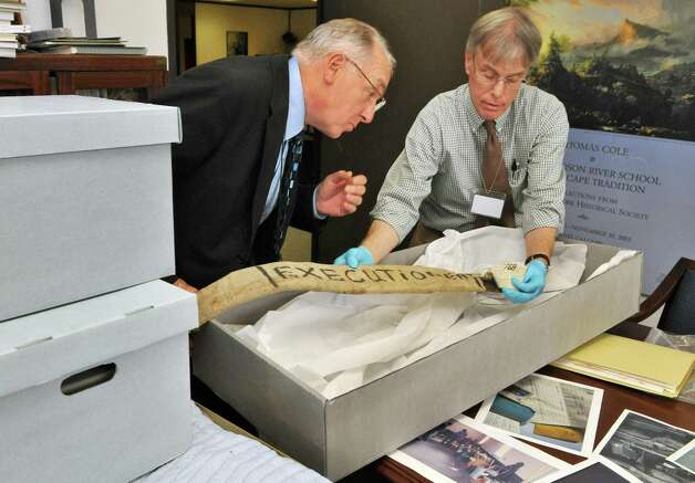 NYS Museum director Clifford Siegfried, left, and curator of history, Craig Williams examine a new trove of archival items from the controversial Attica prison uprising 40 years ago, now at the NYS Museum in Albany Wednesday Sept. 21, 2011.   (John Carl D'Annibale / Times Union) Photo: John Carl D'Annibale / 00014710A