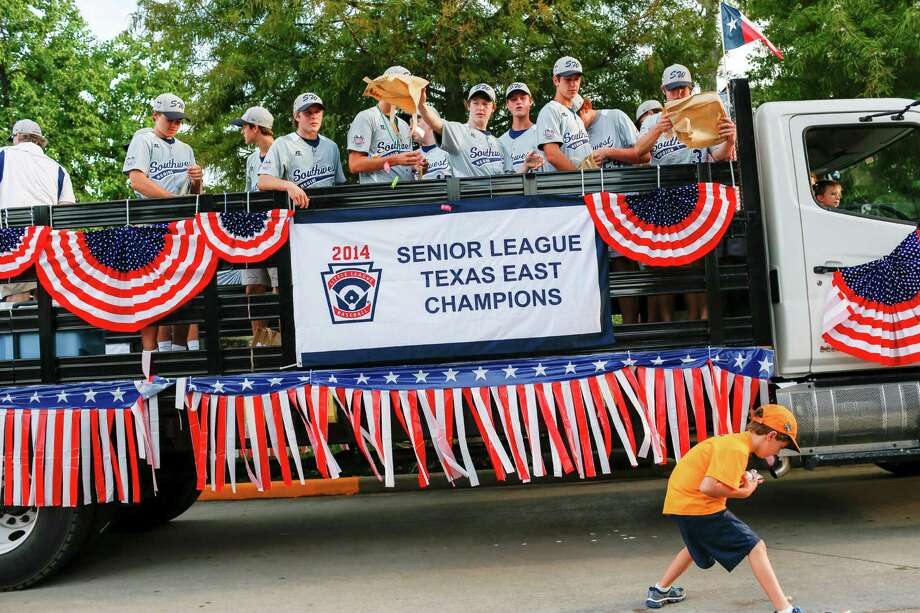 The West University Little League team tosses candy in a parade celebrating their Senior's world championship win, August 28, 2014 in Houston, TX. Photo: Eric Kayne, For The Chronicle / Eric Kayne