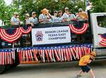 The West University Little League team tosses candy in a parade celebrating their Senior's world championship win, August 28, 2014 in Houston.