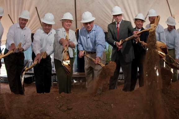 Occidental Petroleum Corp. employees and guests, including Gov. Rick Perry, help turn the dirt this week during the ground-breaking for the corporation's Midland offices.