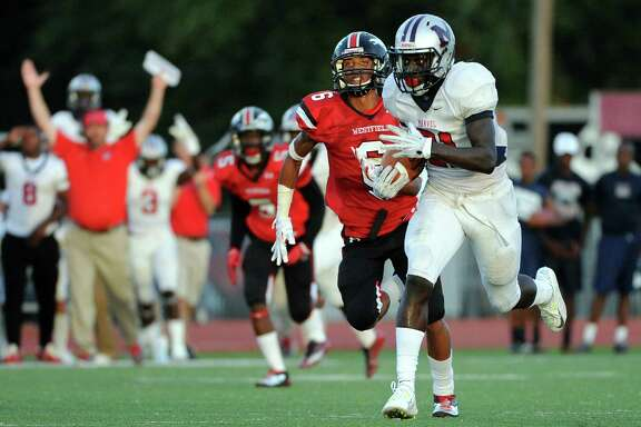 Manvel running back D'Vaughn Pennamon, right, runs past Westfield defensive back McArthur Matson for a 62-yard touchdown during the first half of high school football game against Westfield, Thursday, August 28, 2014, at George Stadium in Spring, TX. (Photo: Eric Christian Smith/For the Chronicle)