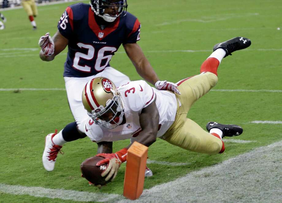 San Francisco 49ers' Bruce Ellington (3) dives past Houston Texans' Brandon Harris (26) for a touchdown during the second quarter of an NFL football preseason game Thursday, Aug. 28, 2014, in Houston. (AP Photo/David J. Phillip) Photo: David J. Phillip, Associated Press / AP
