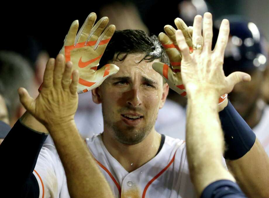 Houston Astros' Jason Castro is congratulated in the dugout after hitting a grand slam against the Texas Rangers in the fifth inning of a baseball game Thursday, Aug. 28, 2014, in Houston. (AP Photo/Pat Sullivan) Photo: Pat Sullivan, STF / AP