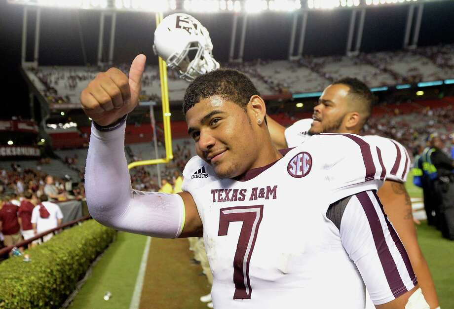 It was all systems go for quarterback Kenny Hill and the A&M offense Thursday night at Williams-Brice Stadium. The Aggies rolled up 52 points and 680 yards against South Carolina. Photo: Grant Halverson, Stringer / 2014 Getty Images